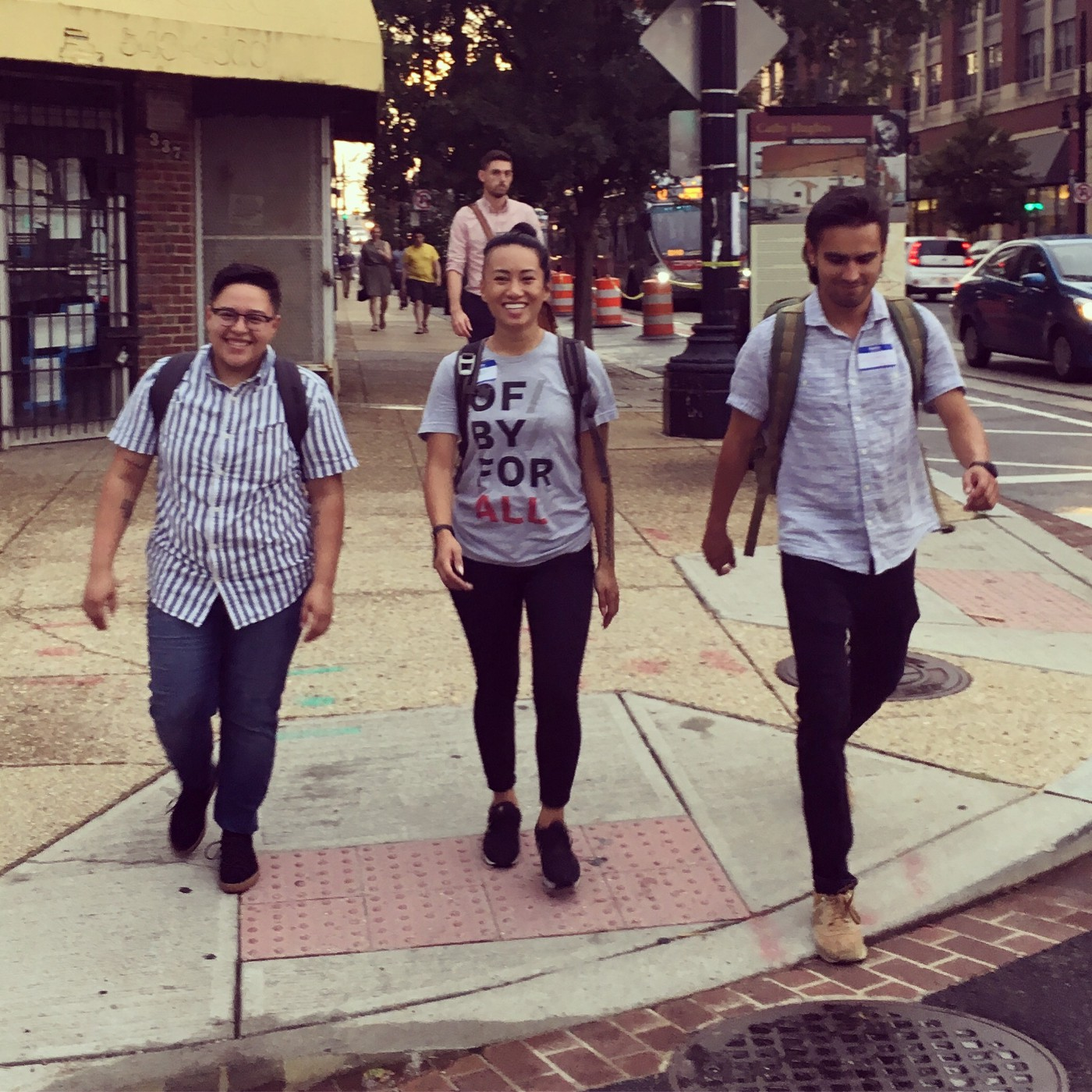 Three team members at OF/BY/FOR ALL walking down the street in Washington, DC.
