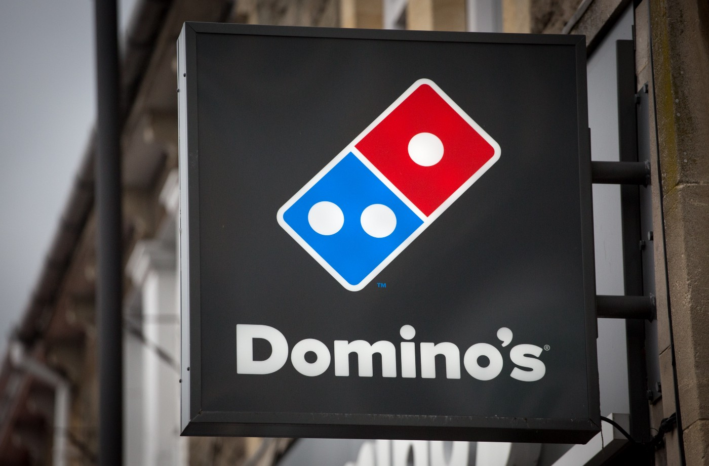 A photo of the Domino's logo for a store.
