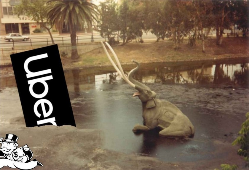 The sinking mammoth exhibition at the La Brea Tar Pits; next to the doomed pachyderm is the Uber logo, also mired in the tar. Monopoly's Rich Uncle Pennybags is partially in the bottom left corner of the frame, running away with a bag of money. Image: Tarcil (modified) CC BY-SA: https://creativecommons.org/licenses/by-sa/4.0/deed.en