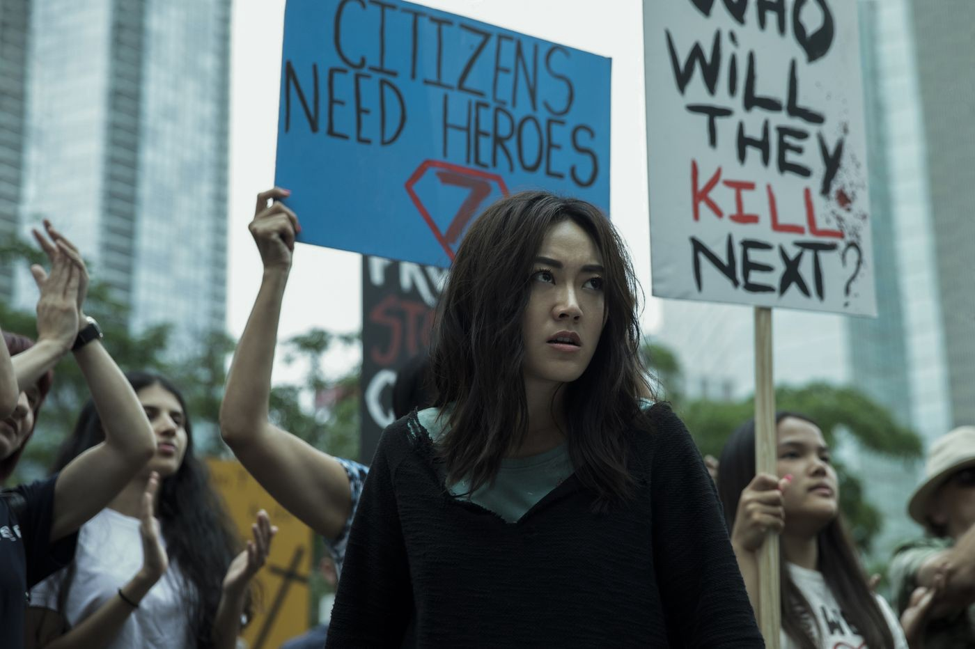 Kimiko at an anti-supe protest, The Boys, Season 2, she wants revenge on Stormfront for murdering her brother.