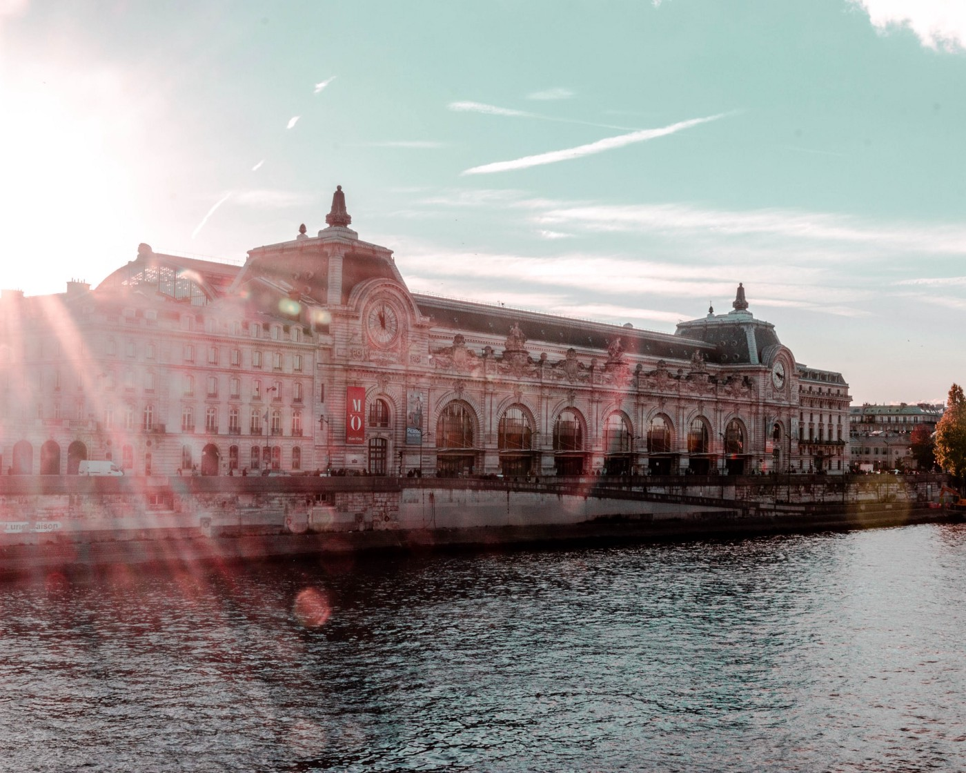 Building of the Orsay museum in Paris near the Seine during sunset.