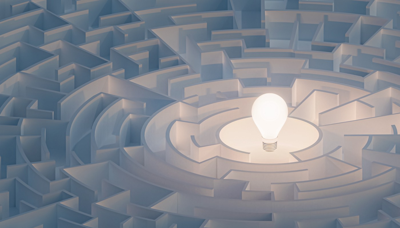 A maze with a light bulb at the center.