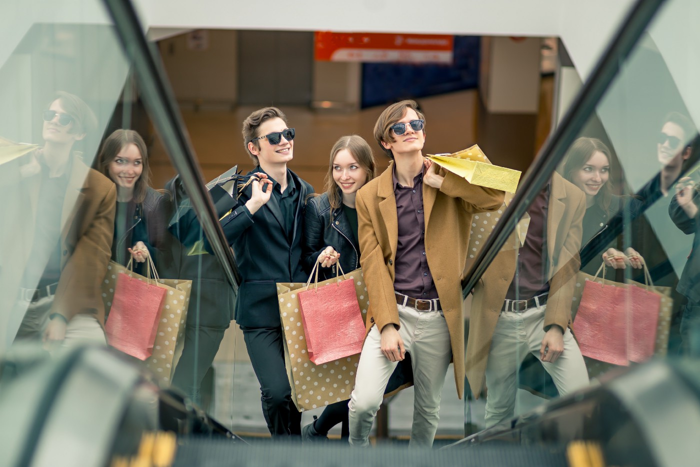 three-girlfriends-escalator-with-shopping-bags—Un Swede