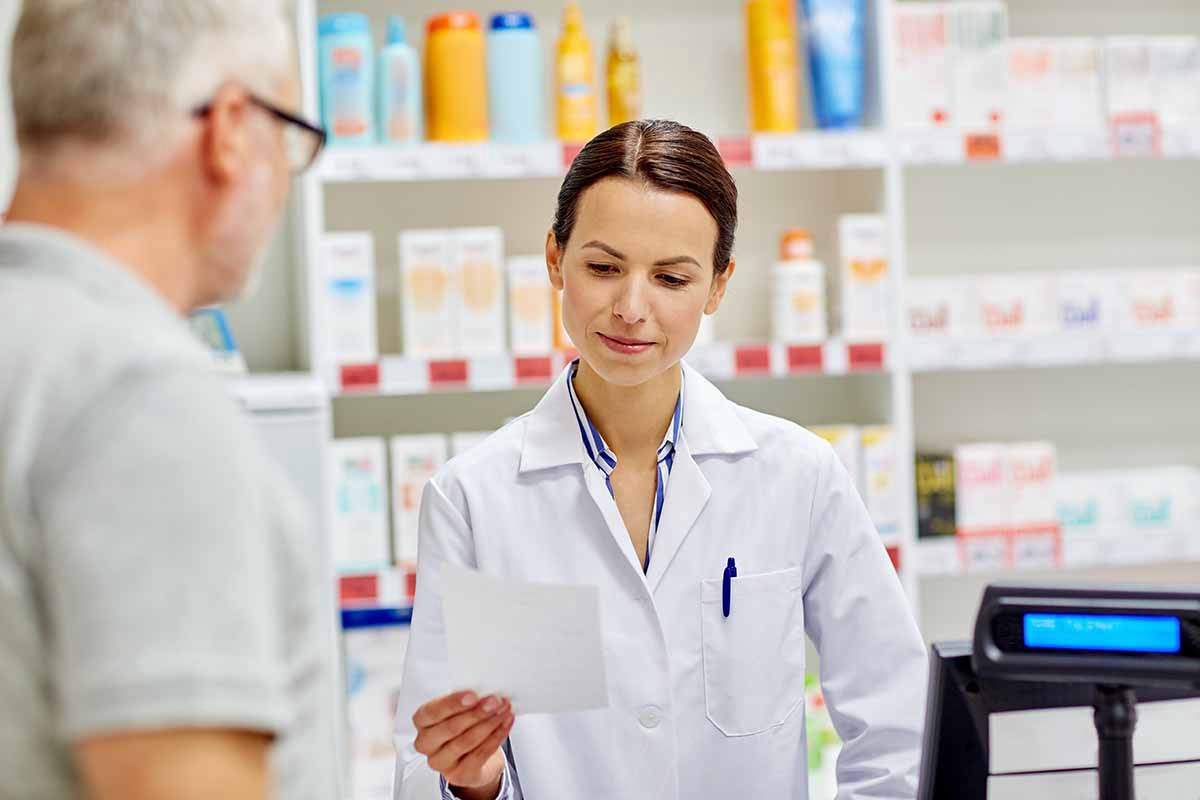 Pharmacists helping customer with prescription