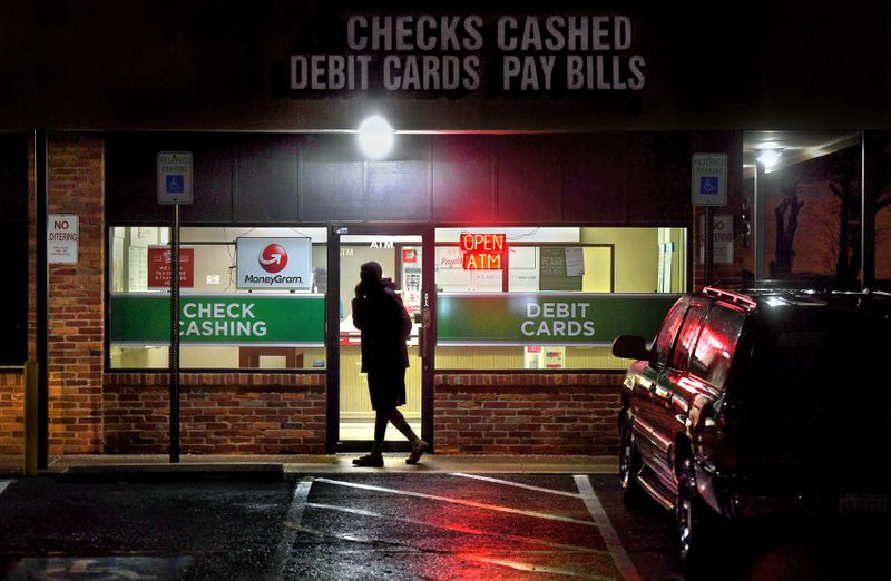 A customer leaves a payday loan store in Gaithersburg, Maryland, in February 2019. Photo by Michael S. Williamson, The Washington Post.