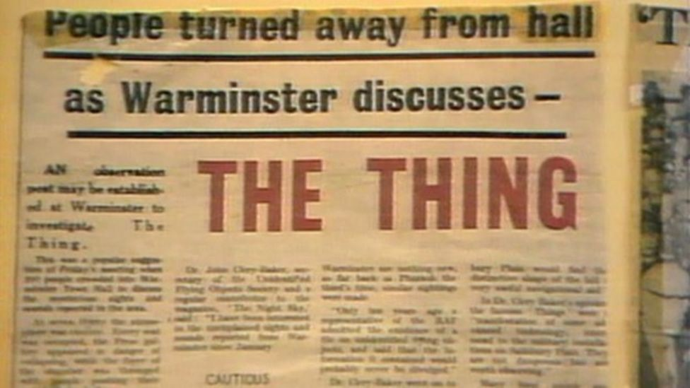Screen shot, still from a video showing a newspaper headline reading 'People turned away from hall as Warminster discusses—THE THING', from 1965.