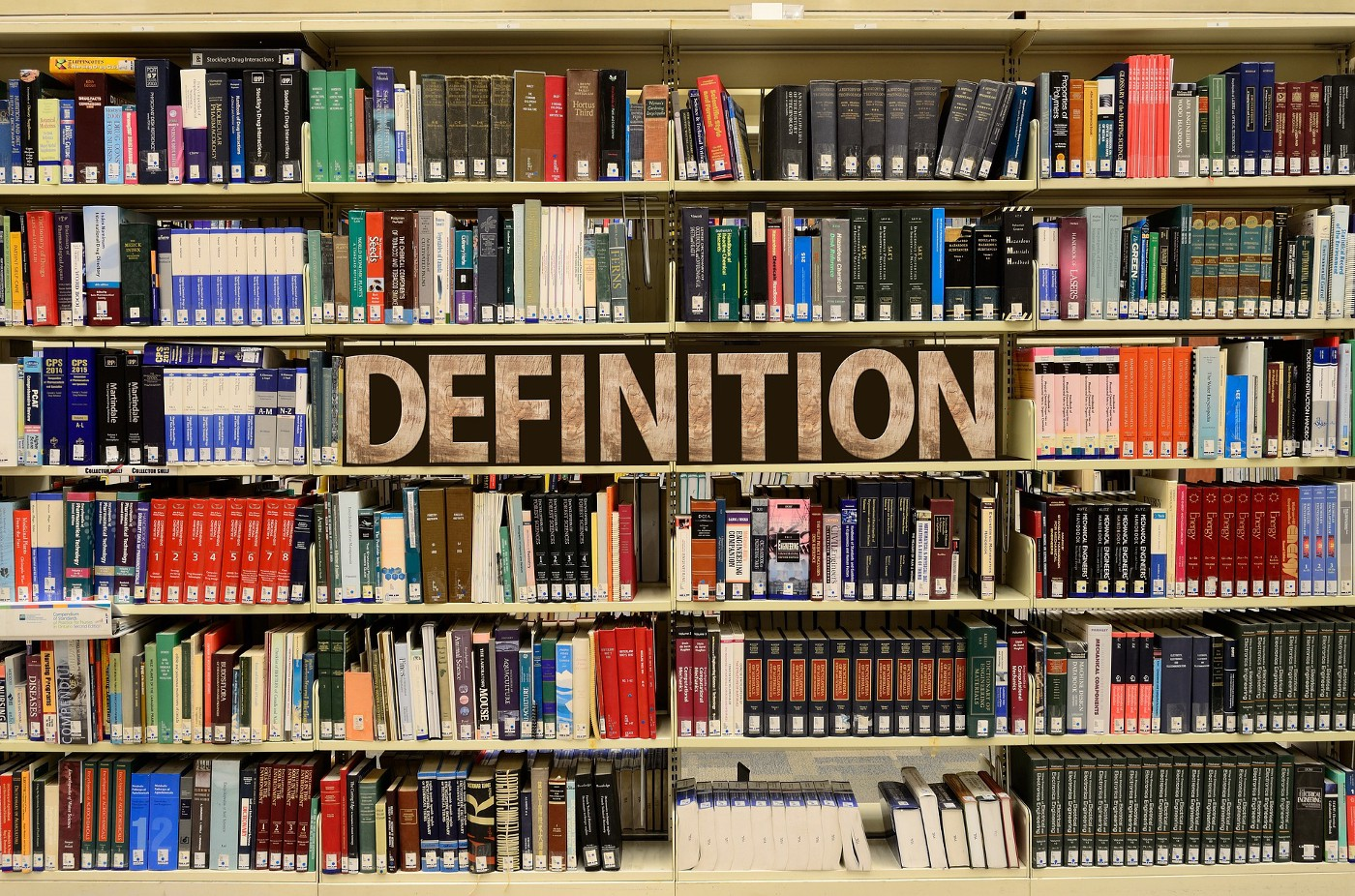 A bookshelf with books and the word definition — referring to the need to define the term innovation.