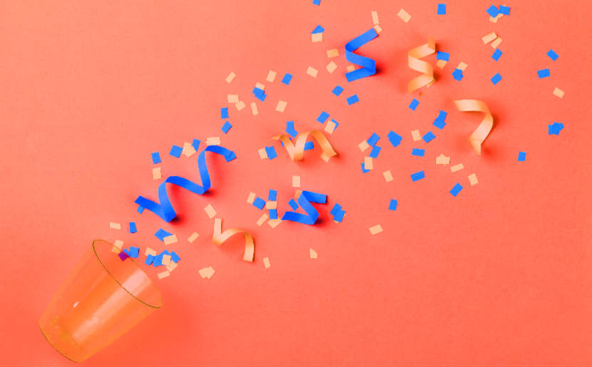 Celebratory confetti spilled out of a cup.