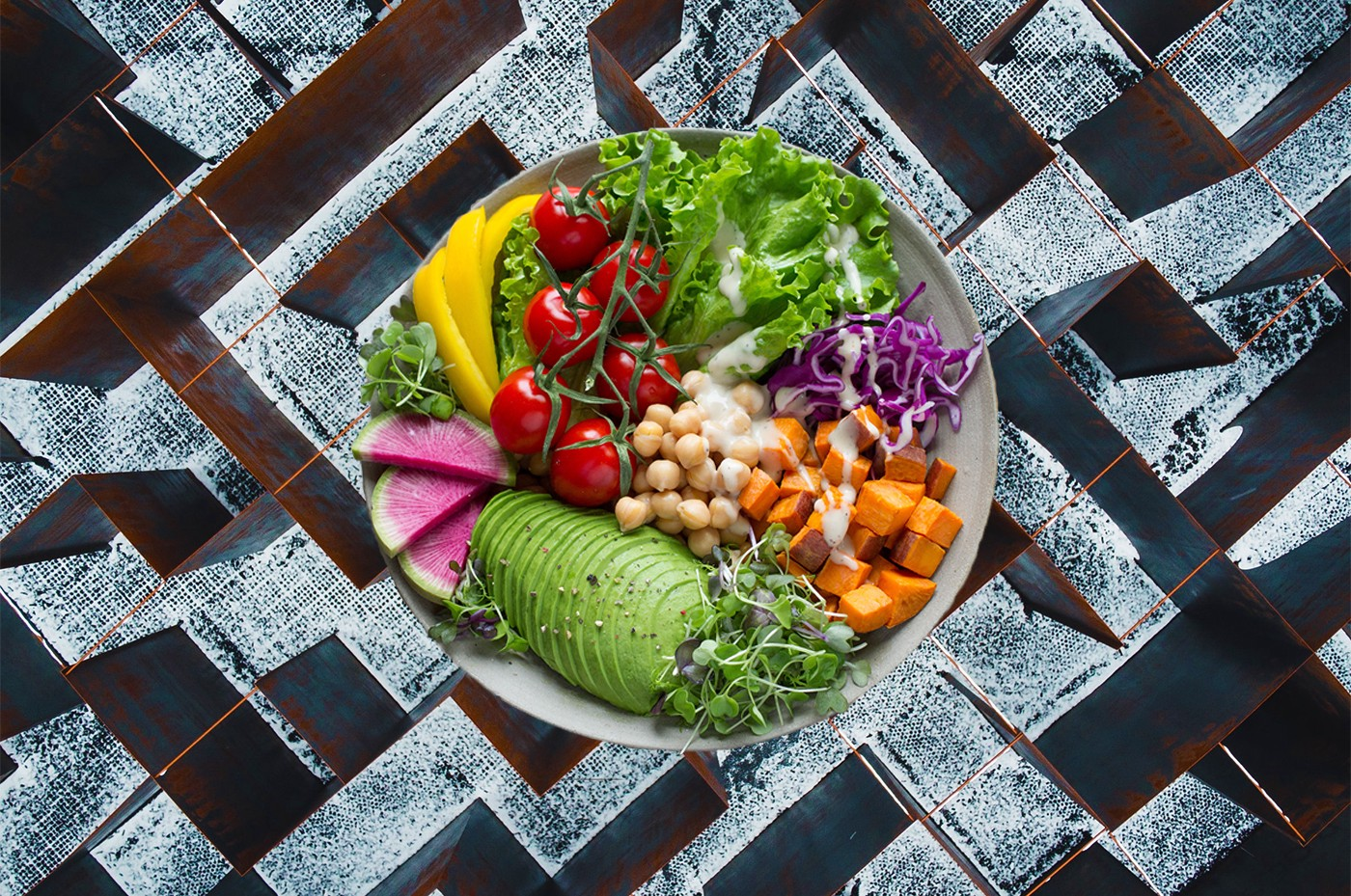 A colorful plate of food superimposed over a labyrinth