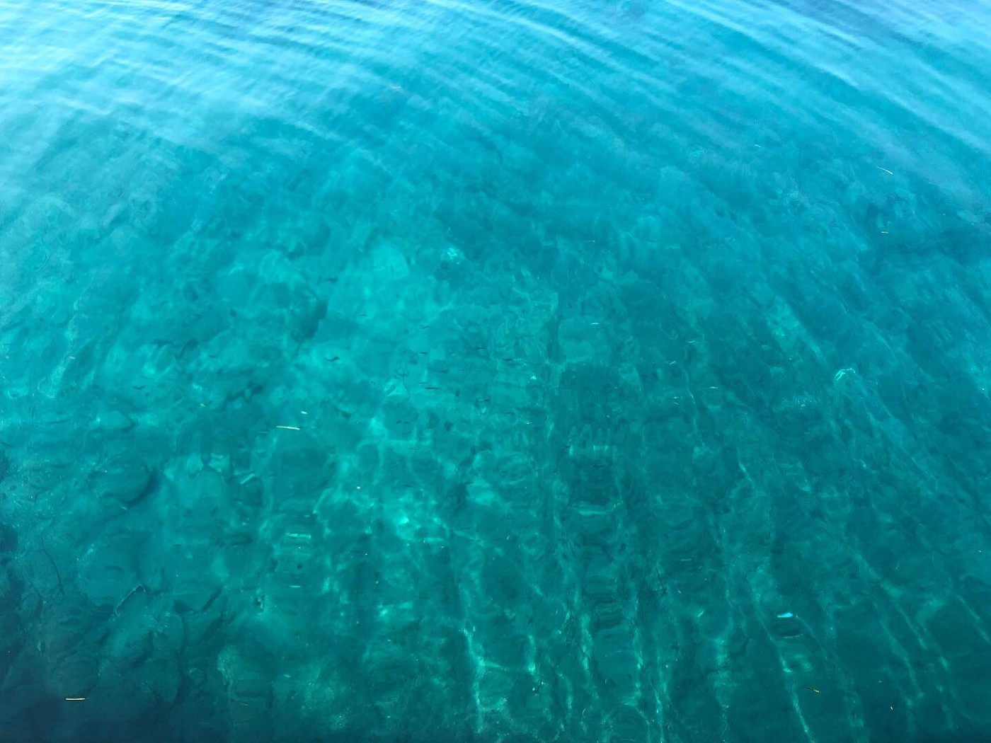 Looking down through the aquamarine waters surrounding the Cyclades.