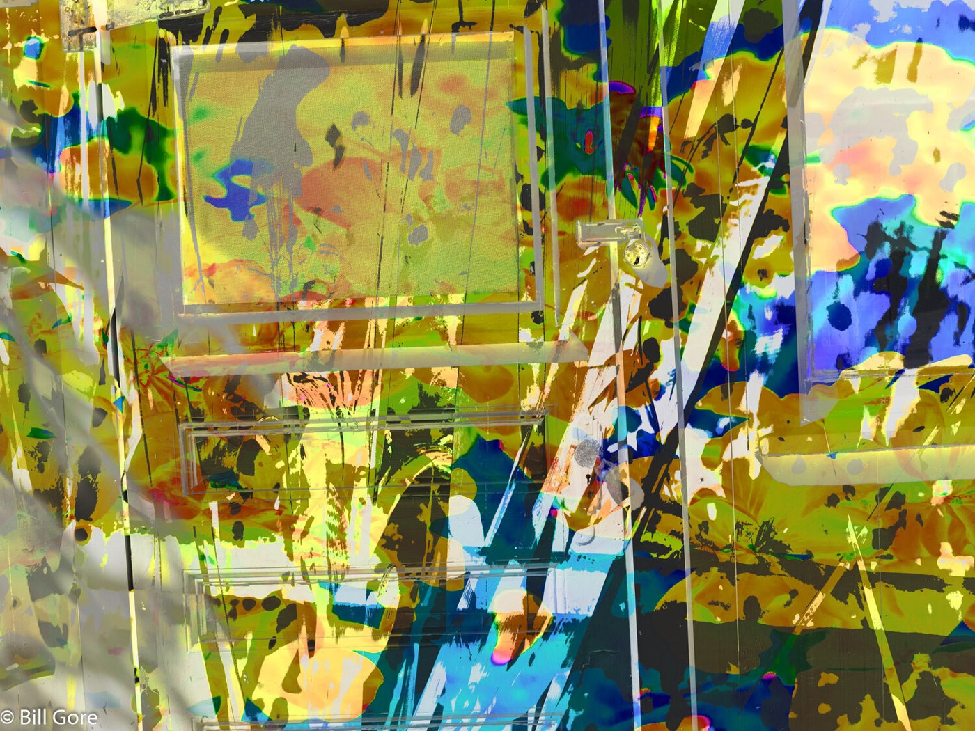 layered photo: geometric and painters palette-like abstraction seen through transparent door.