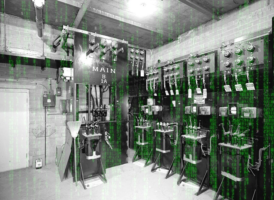 A 1933 photo an electromechanical lab facility superimposed over the Matrix 'code waterfall' effect.