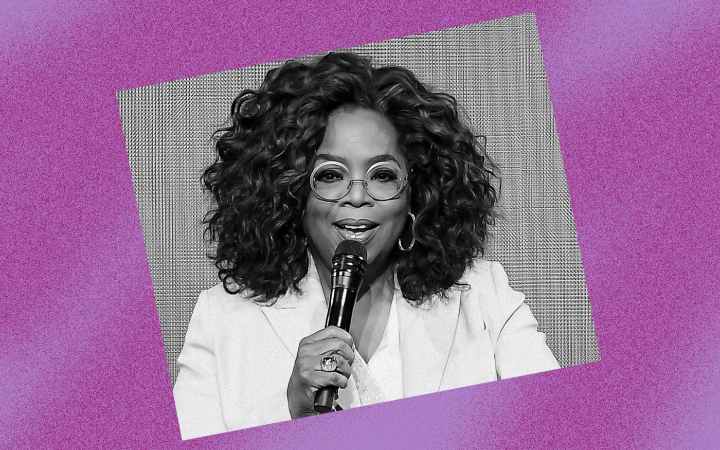Black and white photo of Oprah Winfrey against a violet background.