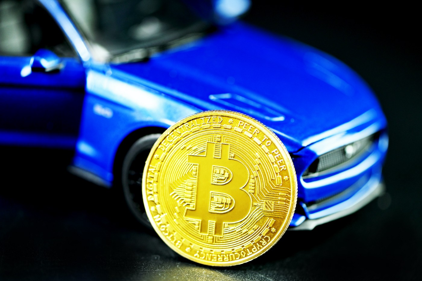 A car with a bitcoin in front