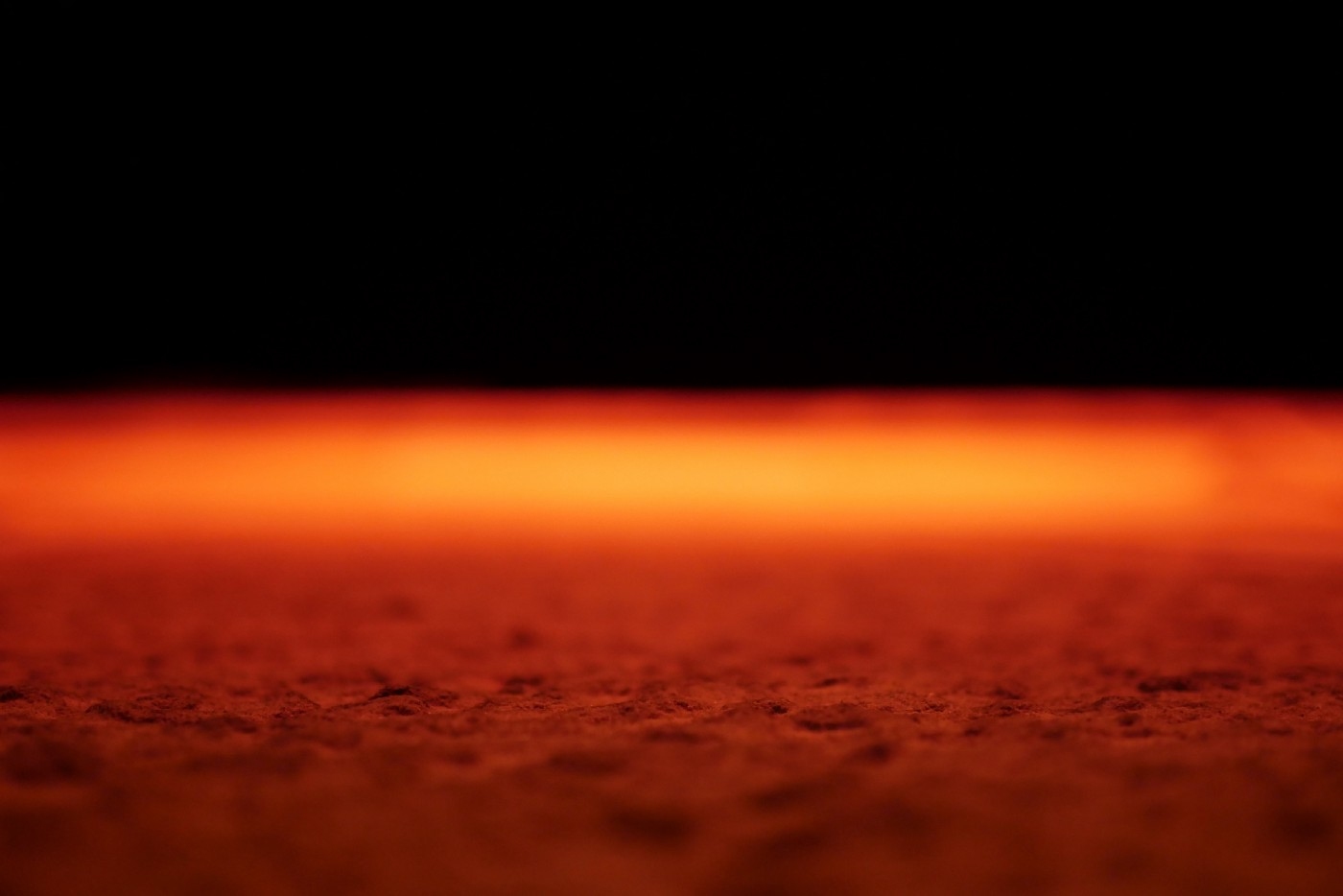 The surface of Mars glowing bright orange against the blackness of space