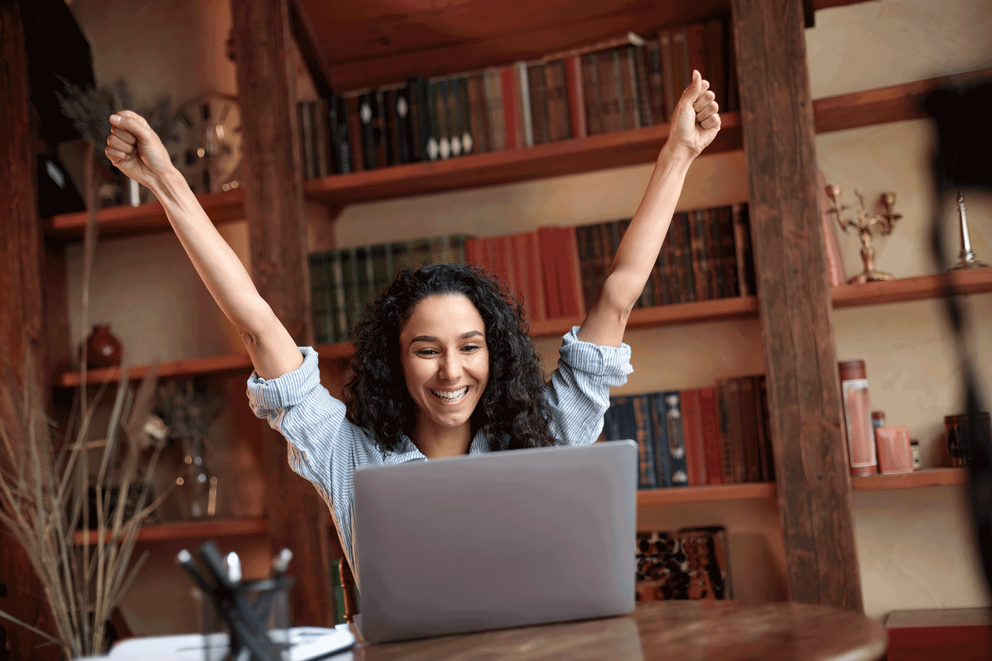 Excited Young Women Achieving Goals at Laptop Computer