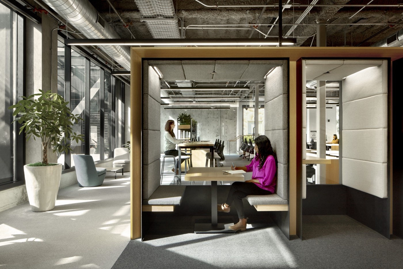 Semi-private spaces are interspersed within work areas.