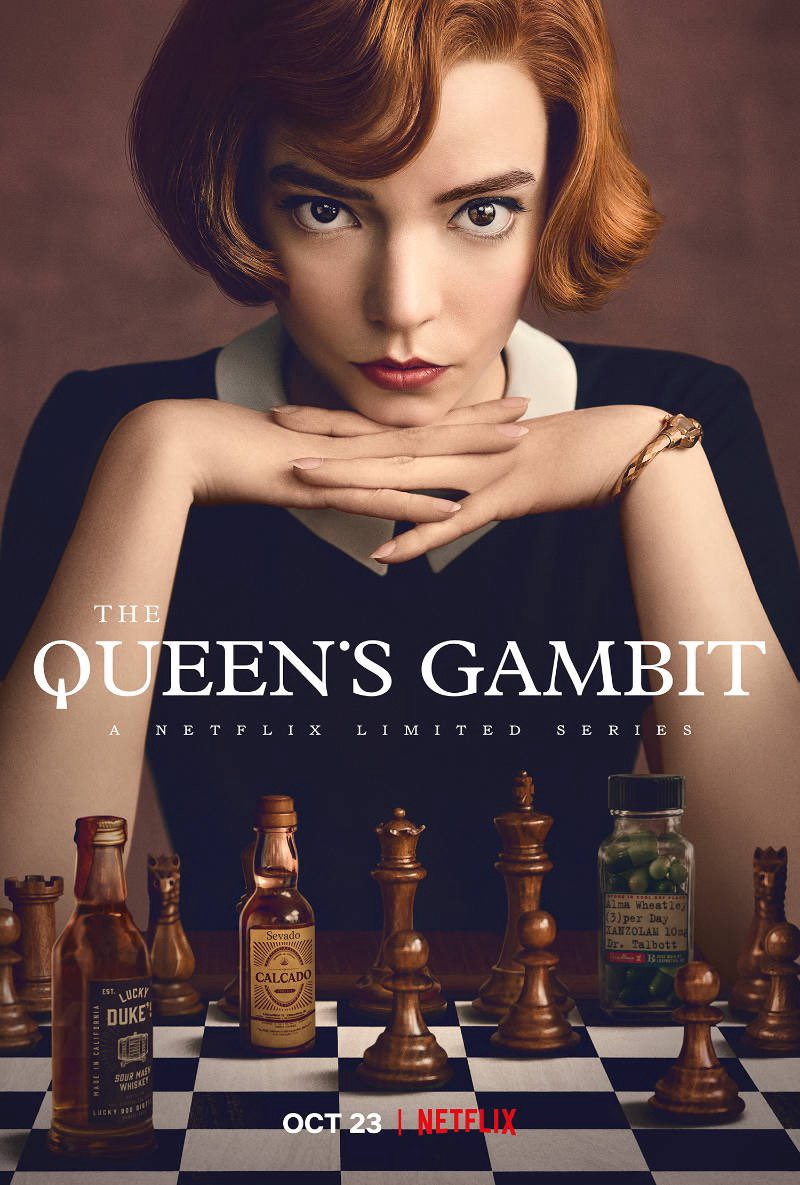 The movie poster of The Queen's Gambit, an image of a woman sitting behing a chessboard.