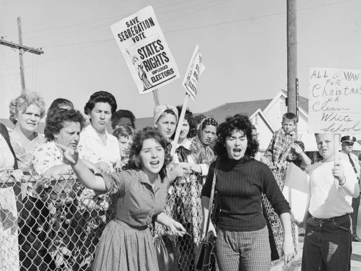 Image of (mostly) white women protesting against integration in black and white