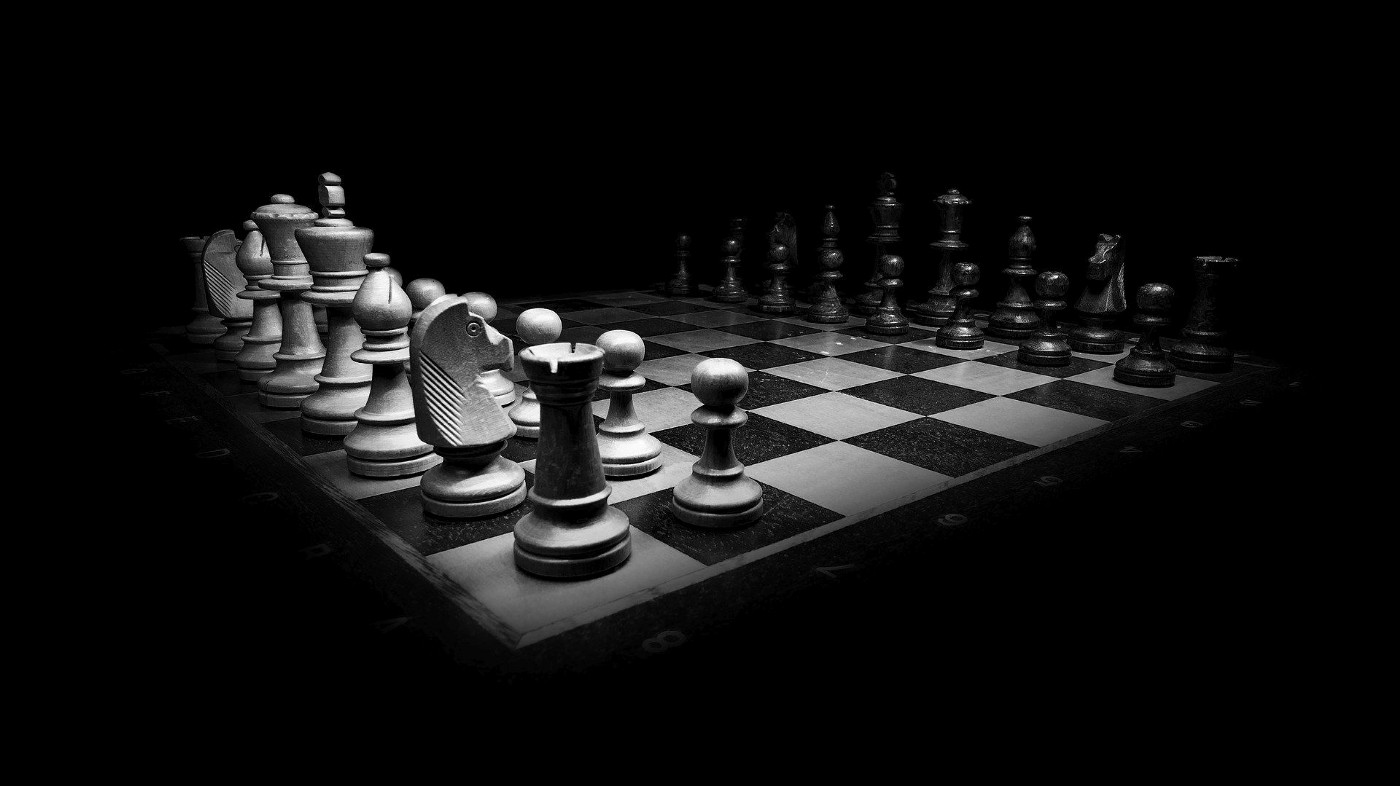 Black and white image of a chess board on a black background