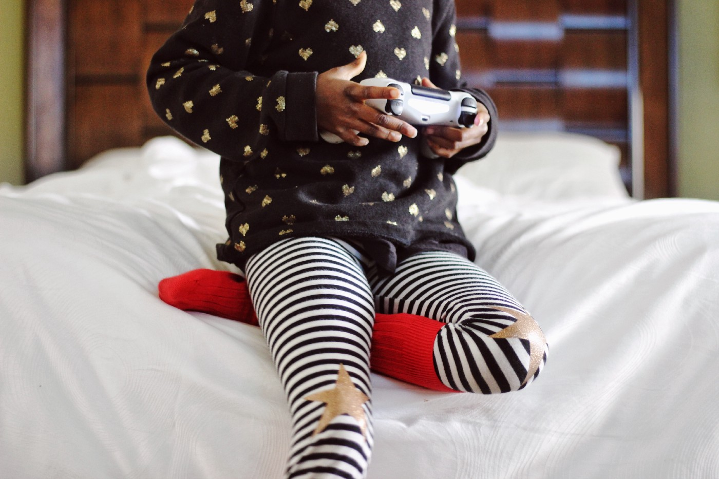 A child plays with a gaming device.