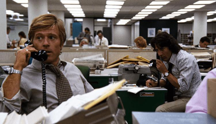 Still from the movie All the President's Men. Robert Redford and Dustin Hoffman sitting in an office, both on the telephone.