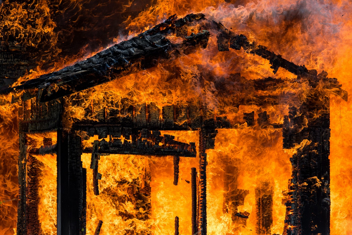 A photo of a burning house.