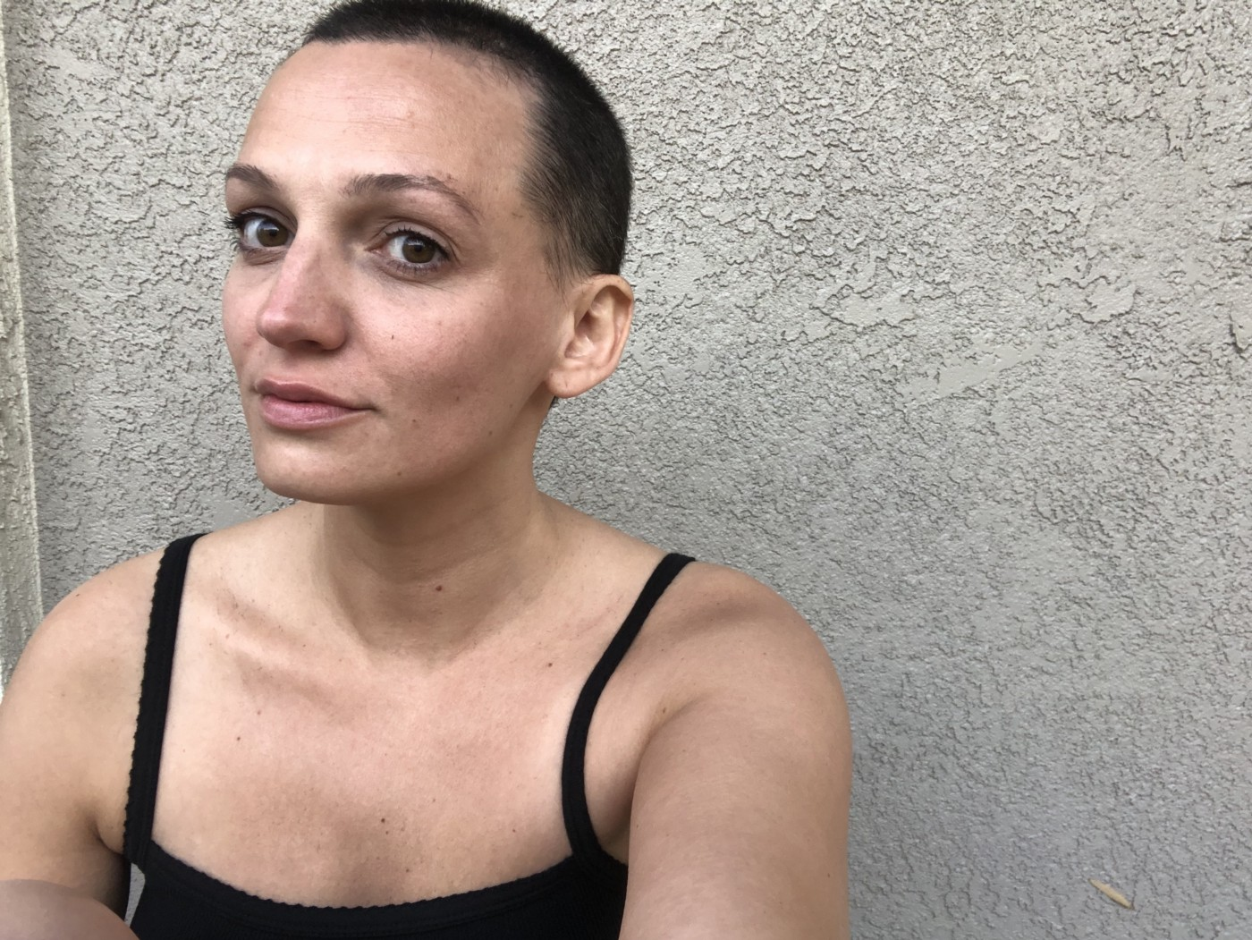 A selfie photo of the author with short cropped hair.