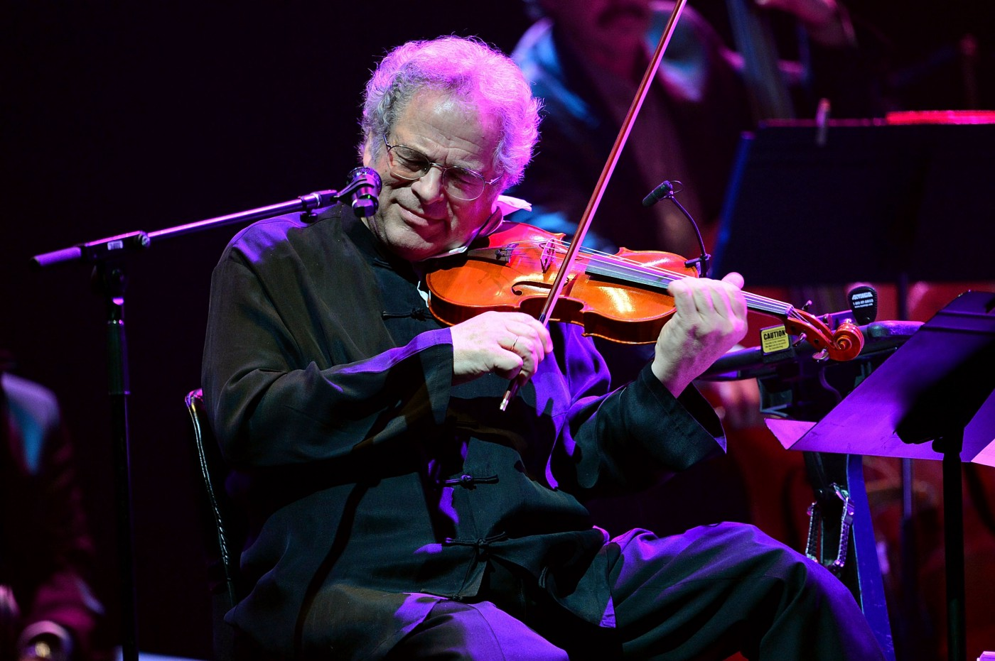 Itzhak Perlman performs at the Barclays Center on February 28, 2013 in New York City.