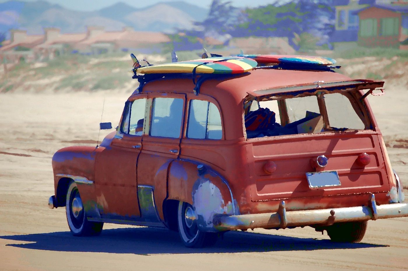 An old jalopy that is carrying surf boards to the beach even after all these years.