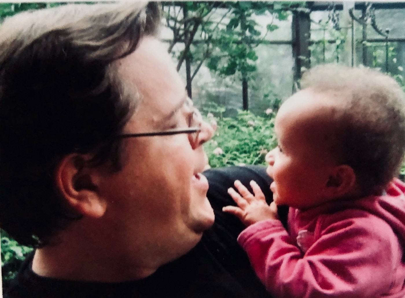 A photo of the author holding his baby daughter.