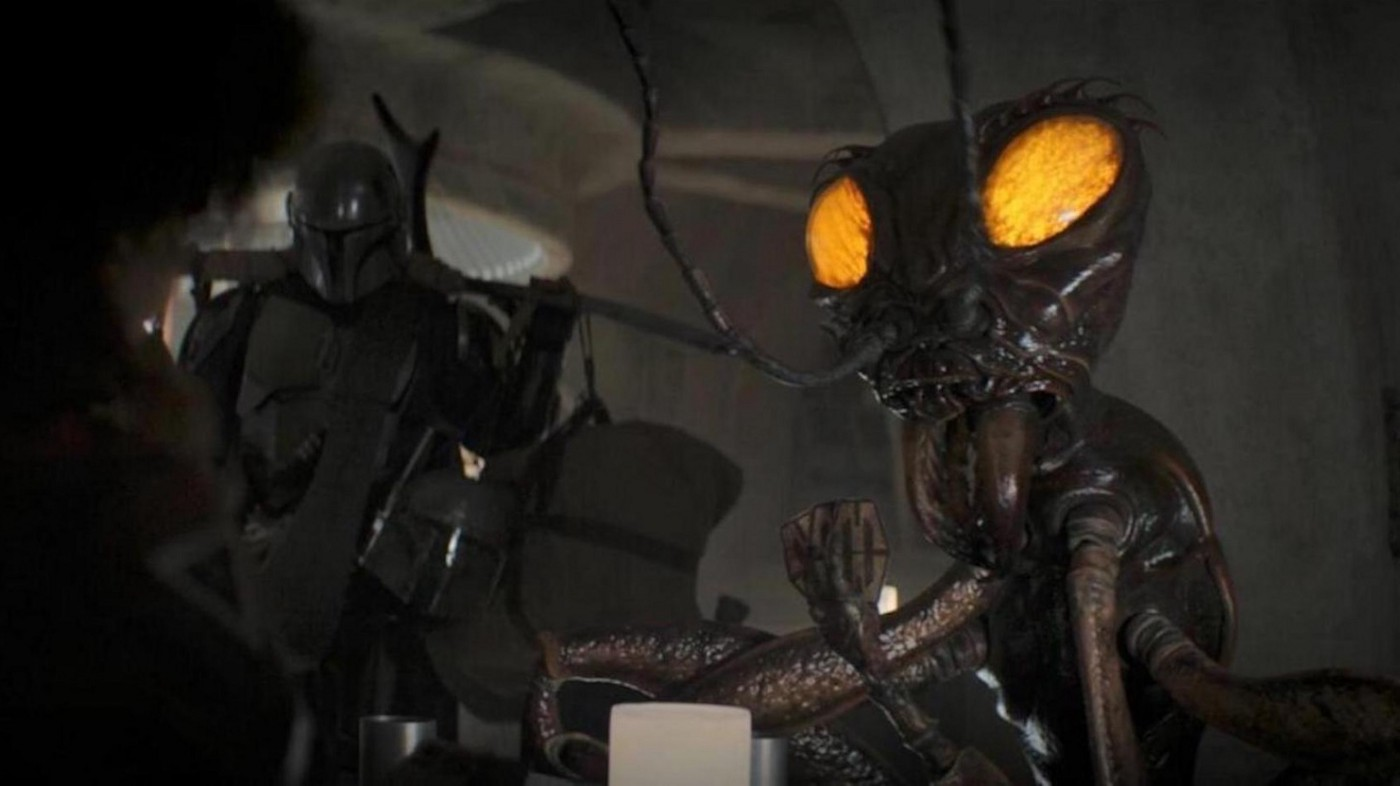 A scene from the Disney+ 'Star Wars' show 'The Mandalorian' featuring a giant insect alien
