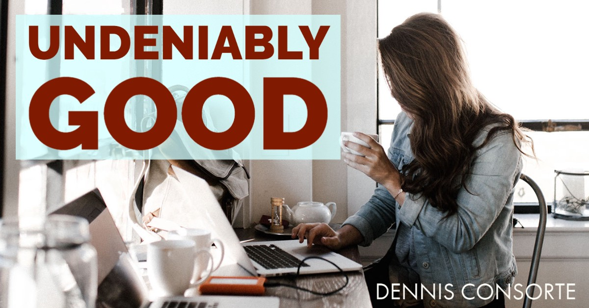 Woman holding coffee cup with two laptops and the text 'undeniably good'
