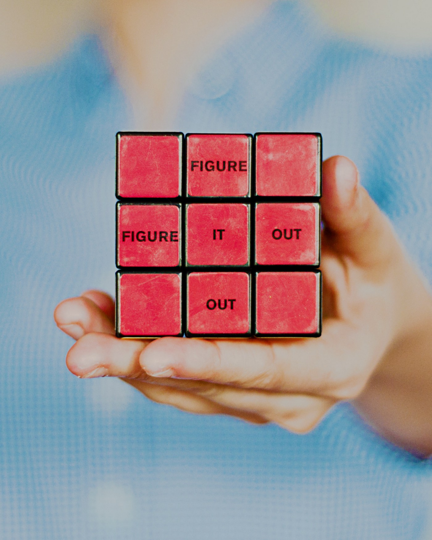 "Picture of a Rubik's cube with the words ""Figure it out"" on it."
