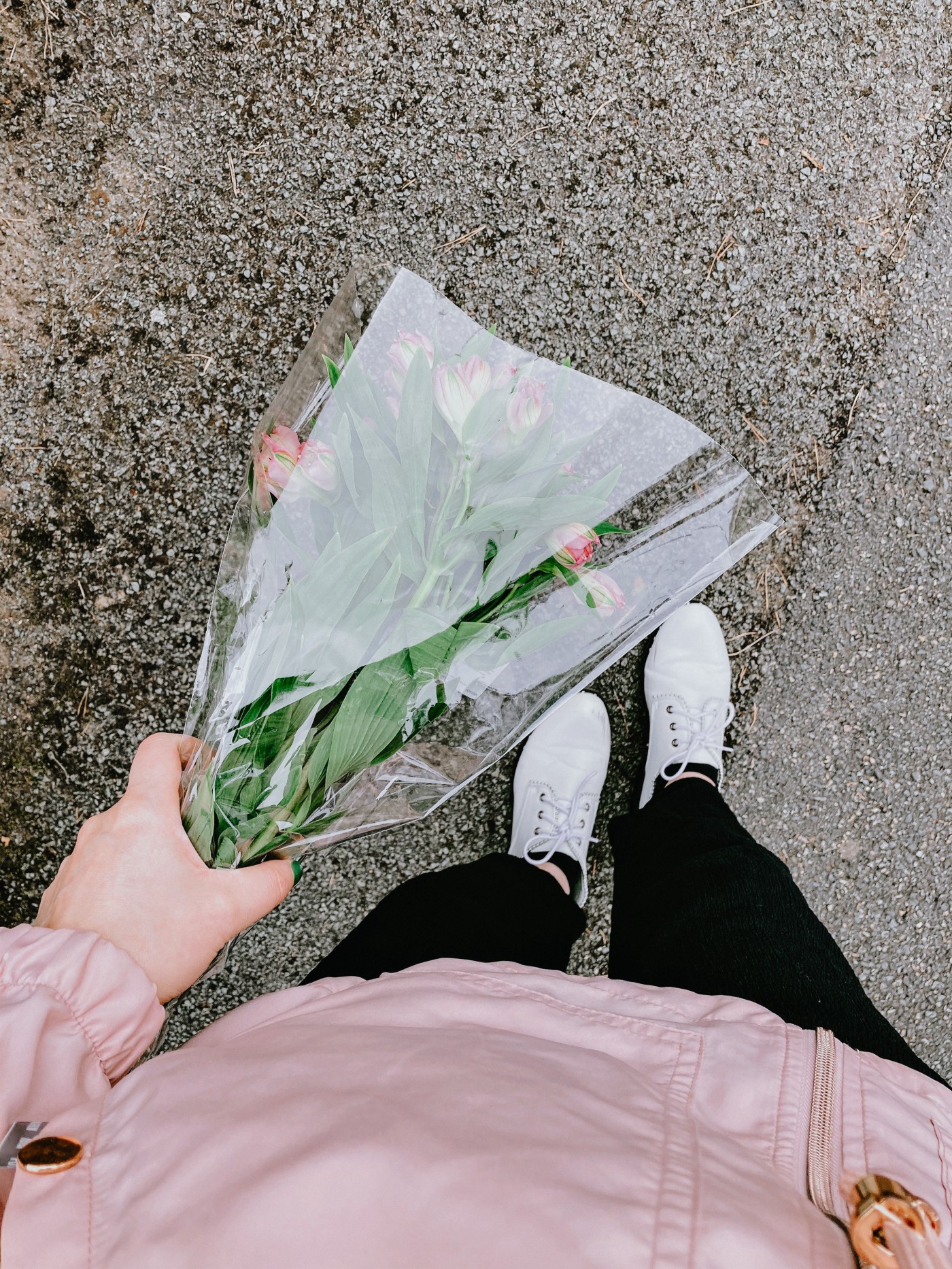 A person holding a bouquet of flowers.