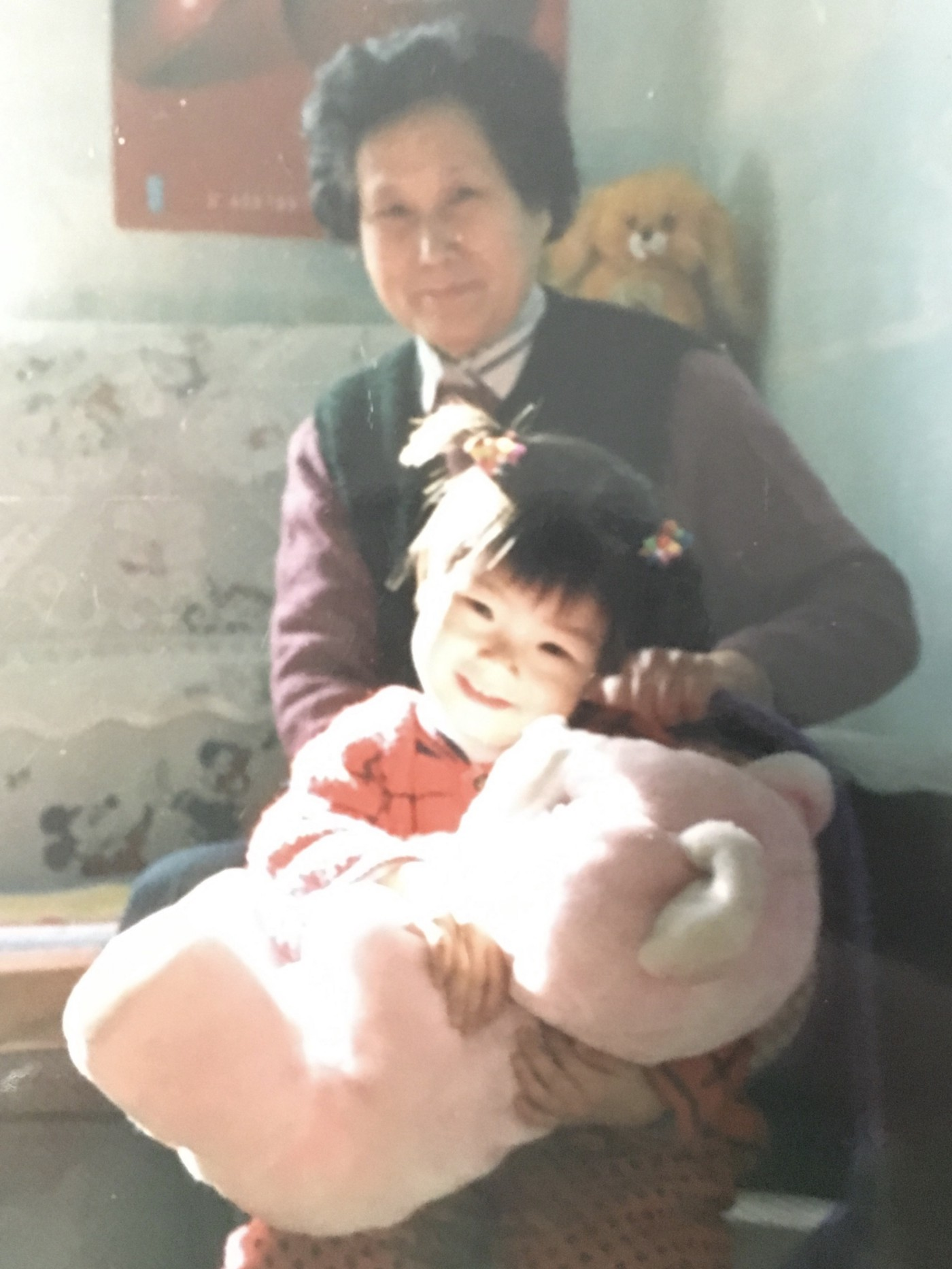A photo of the author as a child with her grandmother.