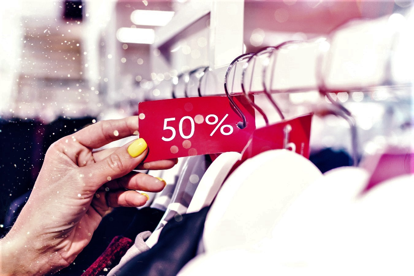 50% off sign on a clothing rack