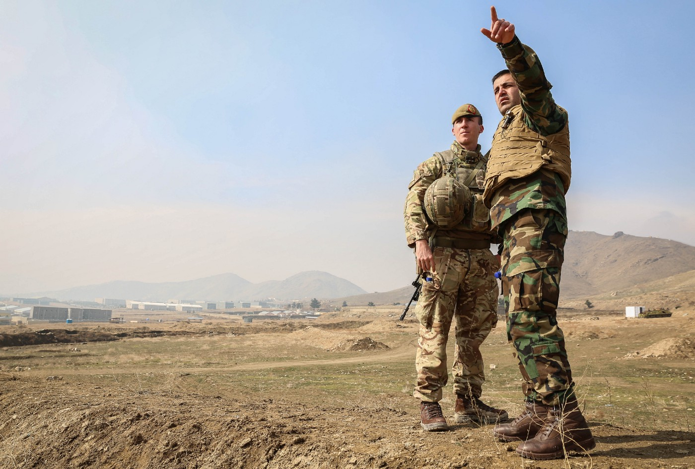 The Afghan National Army Officer Academy Commanding Office converses with Capt Ainsworth, a British Army mentor at ANAOA.