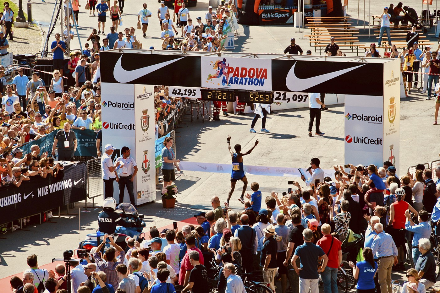 Photo of a runner winning the Padova, Italy marathon (analogy to companies winning in a recession)