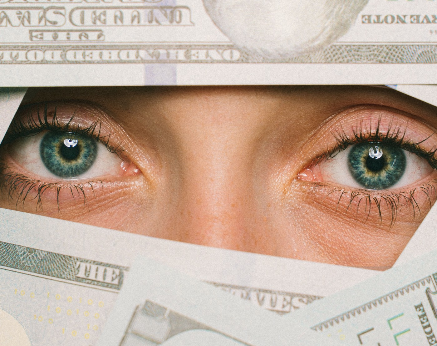 a woman too shy to monetize the community hiding behind dollar bills