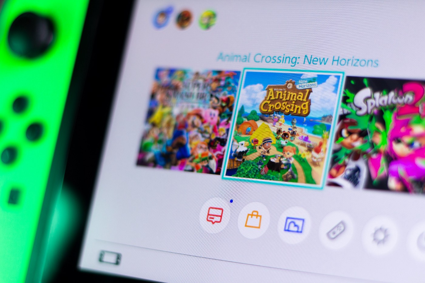 """A photo of a Nintendo Switch menu. """"Animal Crossing: New Horizons"""" is highlighted."""