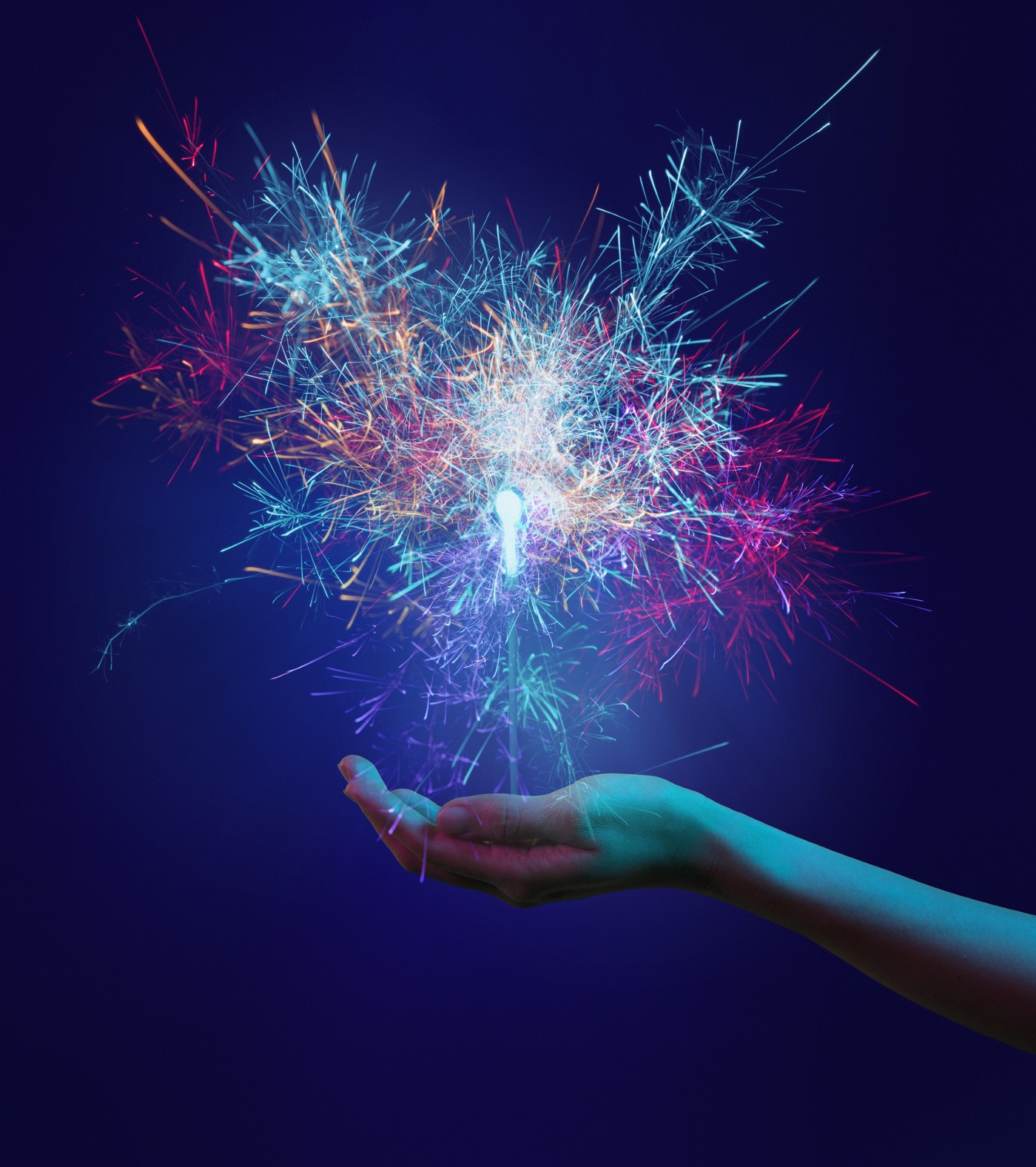 Colorful sparks fly out of the palm of a hand, with a silhouette of a keyhole inside.