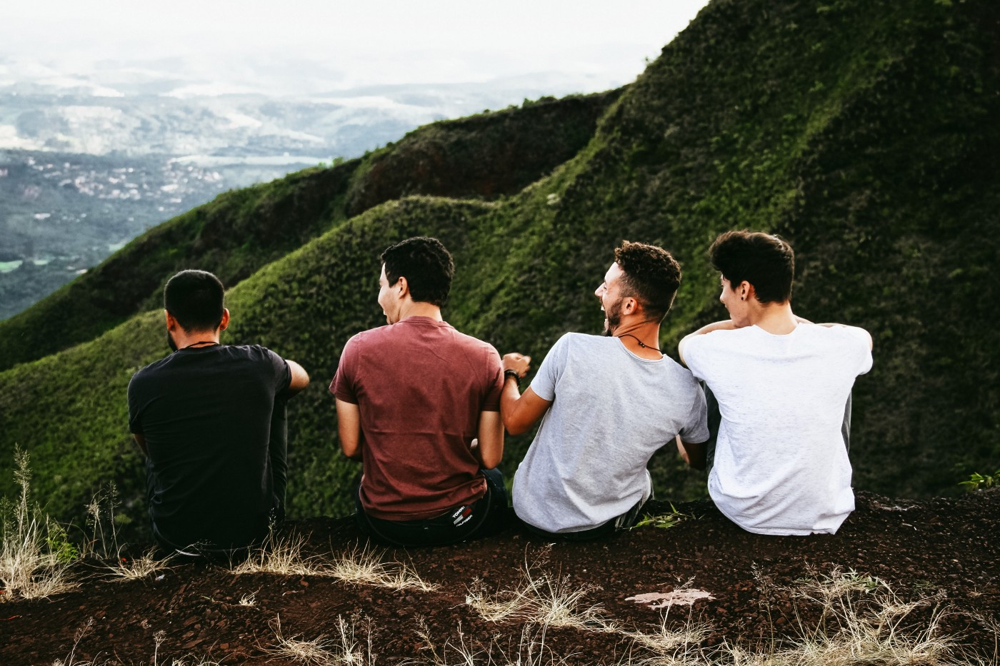 Image of a group of guys sitting together to symbolize being extroverted