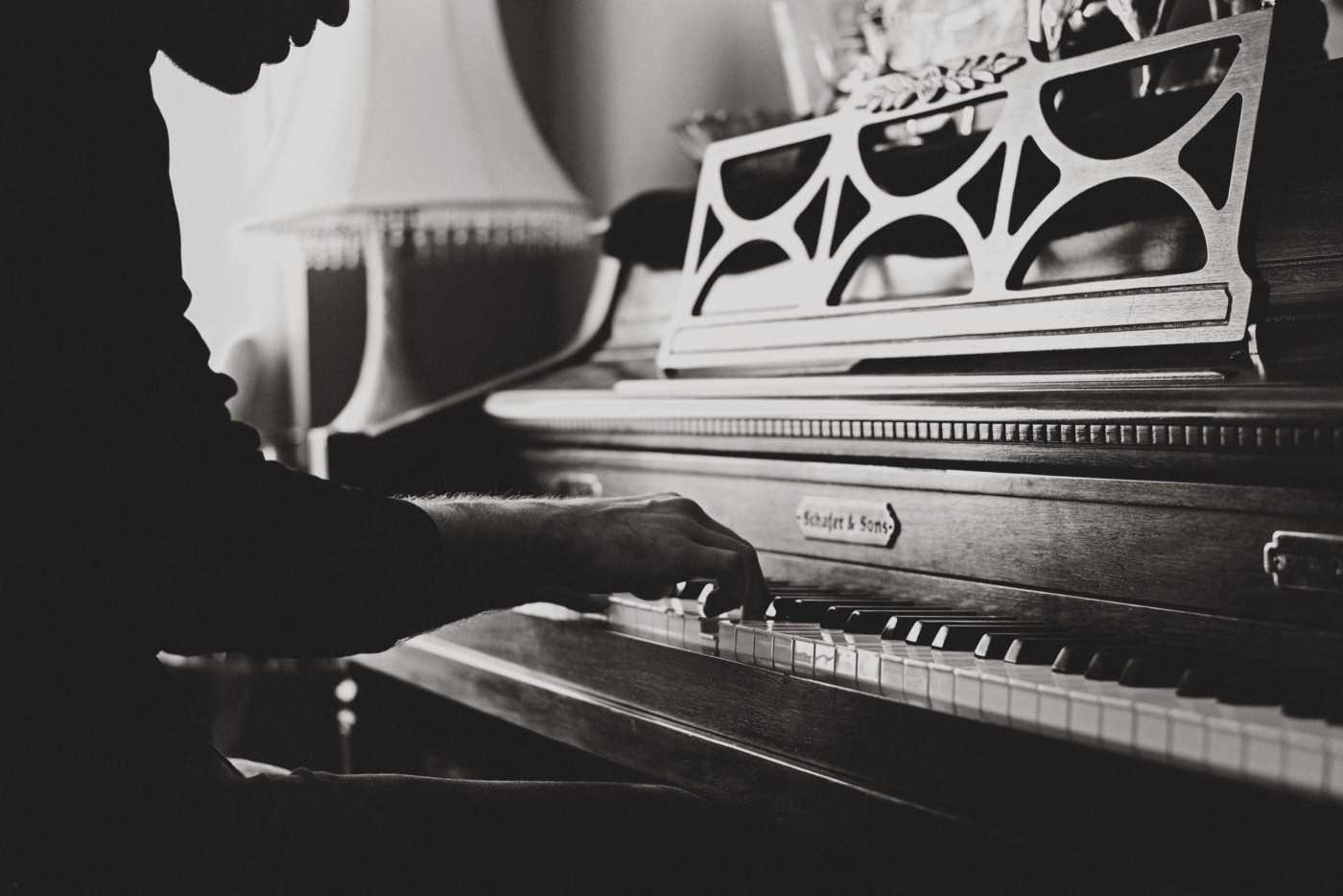 Musician playing piano. Photo by Darius Soodmand on Unsplash
