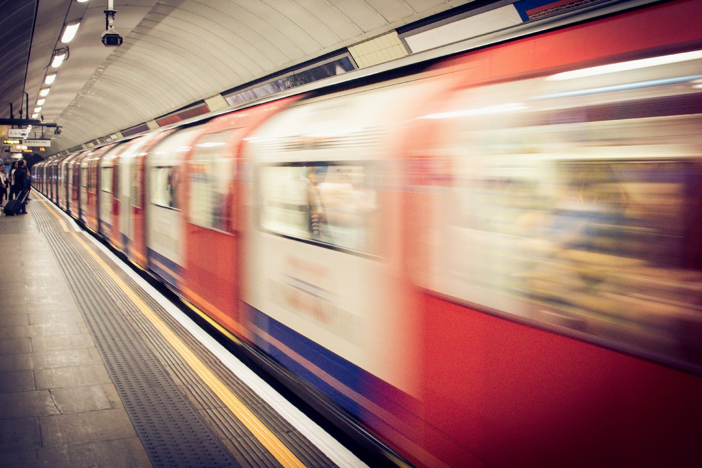 London Underground train blurred as it moves past platform