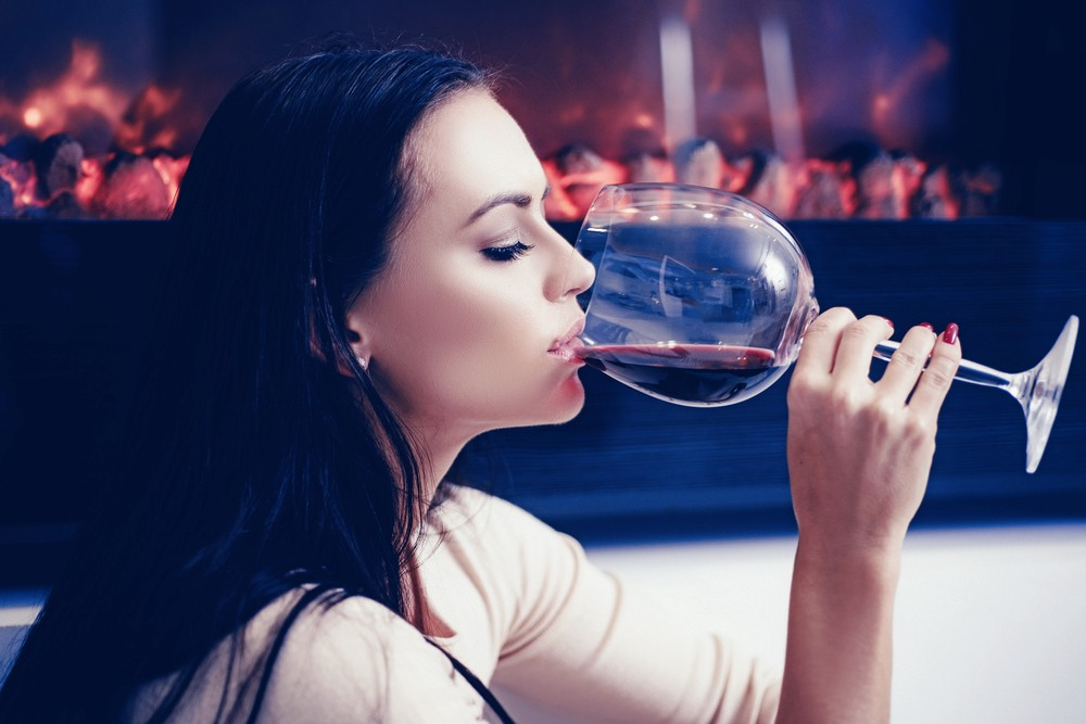 French woman drinking a glass of red wine