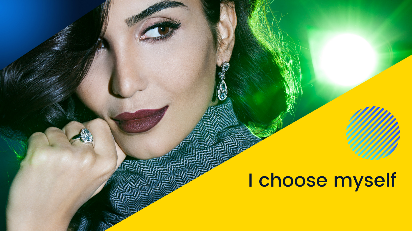 """photo of beautiful smirking Middle Eastern woman in a club with green lights and colorblock that says """"I choose myself"""""""