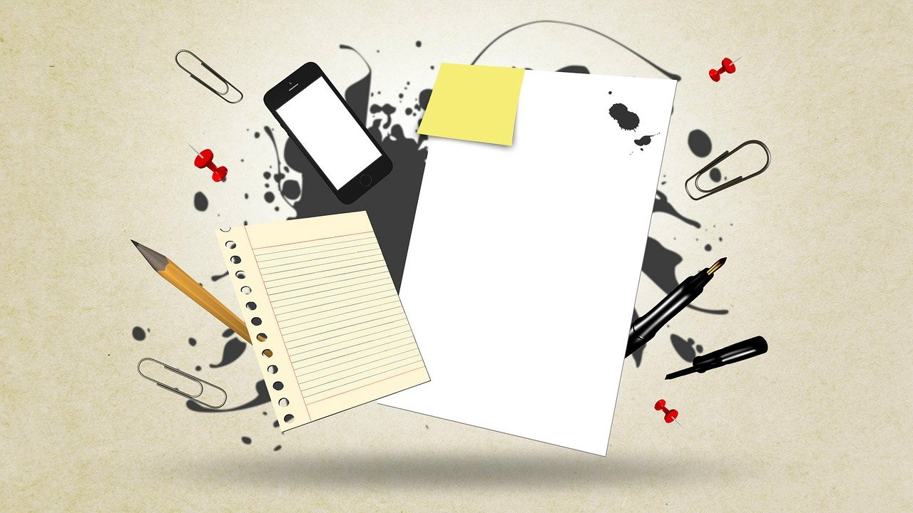A block of white paper, lined paper, sticky note, a mobile phone, pens, pencils and paper clips explode from the centre.