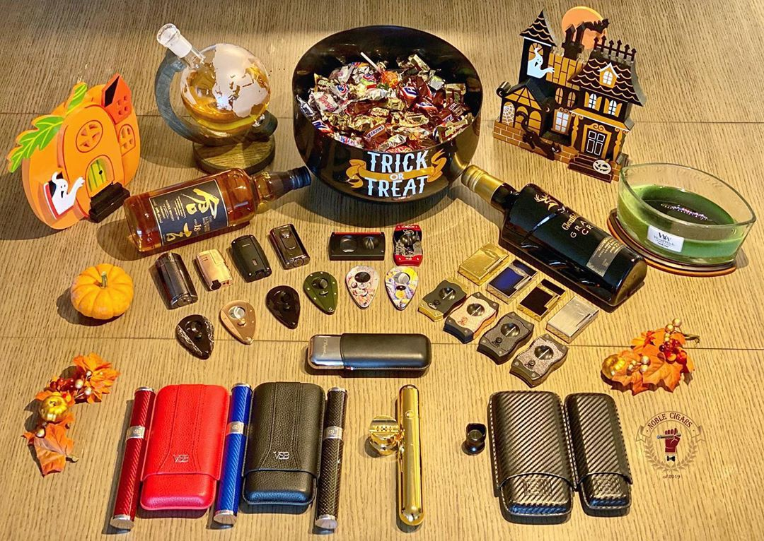 Cigar accessories displayed on top of a table