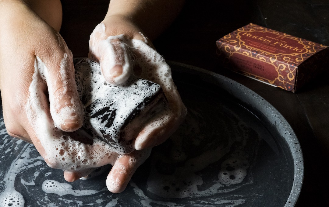 Creating suds in hands with a Rudas Baths mineral soap